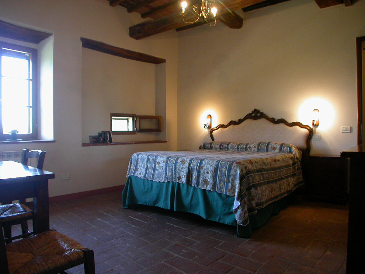 Bedroom two San Giovanni East: historic room in the Castle - Chianti villa rentals